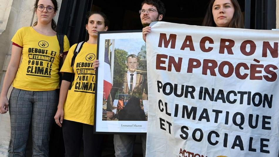 Juicio en París contra ocho ambientalistas por retirar retratos de Macron. (Foto: AFP)