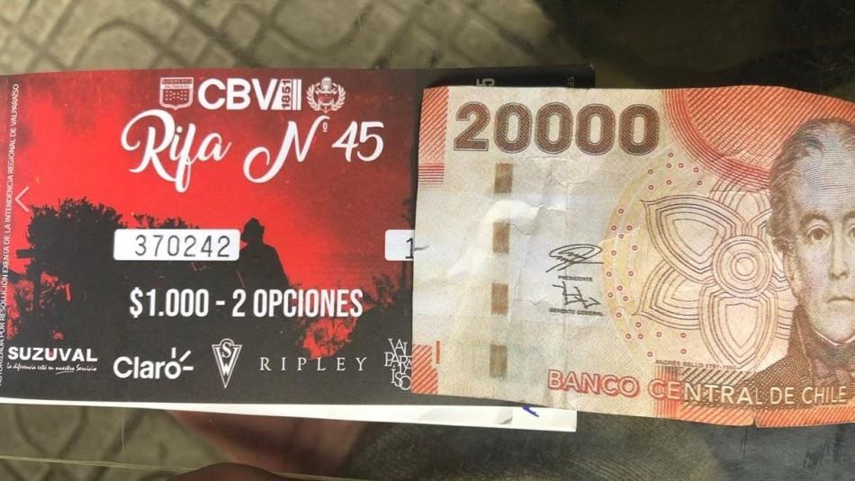Bomberos denuncia que sujeto compró números de rifa benéfica con billete falso